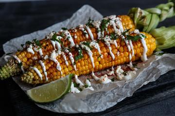 mexican grilled corn, elote, dark photo