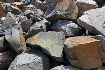 A lot of huge granite stones lying loose. Industry and stone min