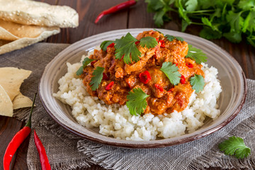 Chicken curry with rice and cilantro.