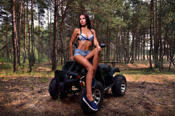 sexy girl near the quad bike. ATV concept
