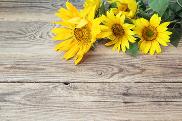 Background with yellow sunflowers on old wooden boards.