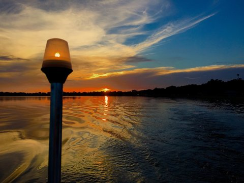 Sunset at the Chain of Lakes in Winter Haven, Florida from a boat on a lake