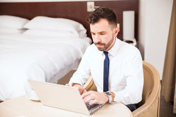 Businessman working in his hotel room