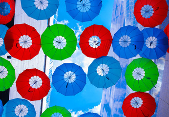 Colorful umbrellas over head