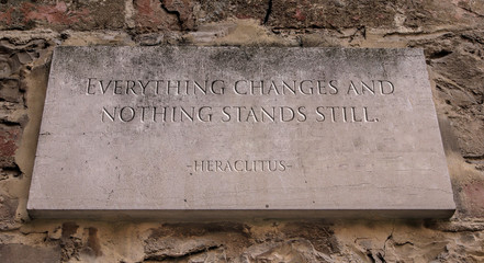 Everything changes and nothing stands still. Is a saying of the Greek philosopher Heraclitus. Engraved text.