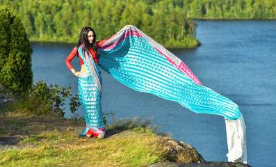 Arabic woman outdoor portrait with flying sari scarf