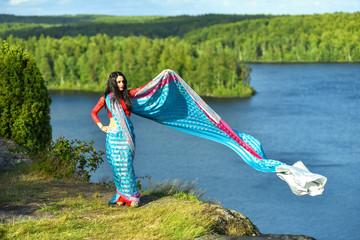 Oriental girl in Swedish nature