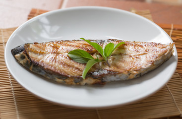 A fried fish on plate.