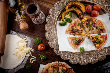 Pizza and red wine on wooden table