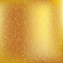 Water drops on the full beer glass.