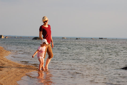 woman and child at the beach