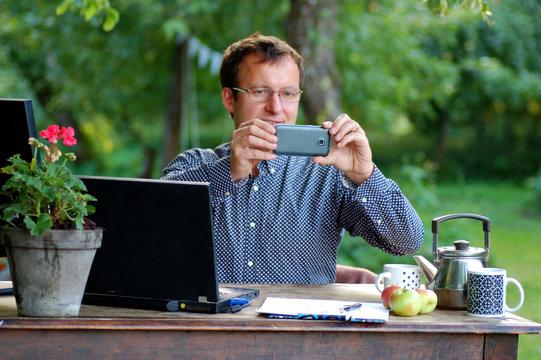 man taking selfie in an outdoor office space