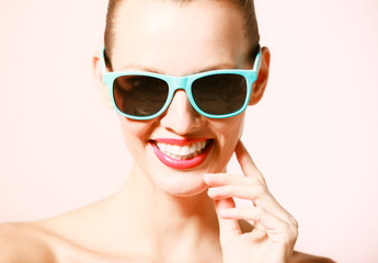 Portrait of happy beautiful woman wearing sunglasses.