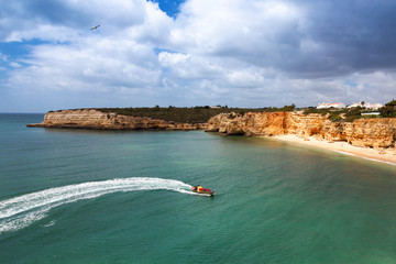 Wall Mural - Speedboat at sea, view from above. Algarve, Portugal, Armacao de Pera
