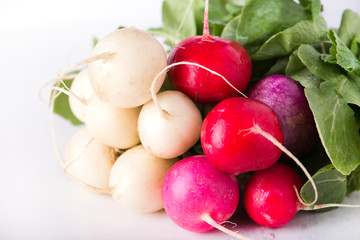 bunch of organically grown, freshly harvested, colorful Easter egg radishes, isolated over white board, close up, horizontal