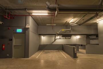 Parking garage in modern building with warm lighting
