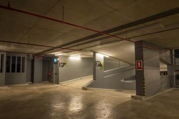 Parking garage indoors at night