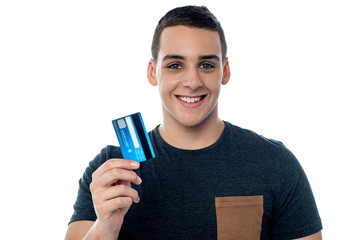 Young man holding credit card