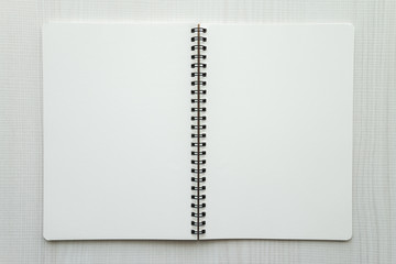 Blank empty notepad on white wooden table