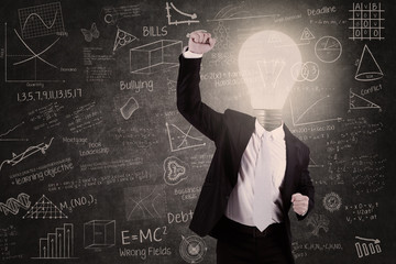 Successful teacher with lightbulb head raised hand in class