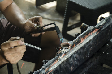 Thai people use lead and gas welding for fix and solder radiator