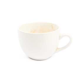 Cup with coffee leftovers isolated