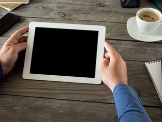 Man holding tablet with blank screen