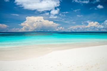 Beautiful tropical island white sand beach with blue sky, Koh Tachi island Thailand