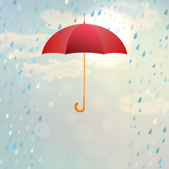 Red opened umbrella with rain