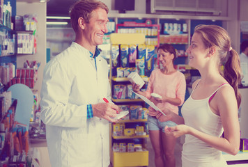 man pharmacist in pharmaceutical shop .