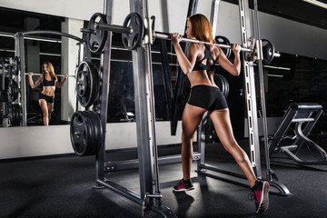 Beautiful sporty woman doing squat