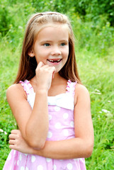 Portrait of adorable smiling little girl in summer day
