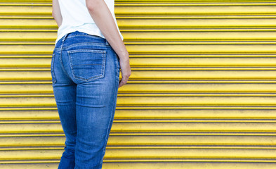 Closeup of woman posing in jeans.