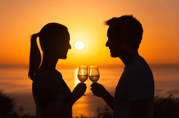 Young couple enjoying a glass of wine and each others company.