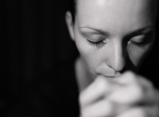 Portrait of woman praying.