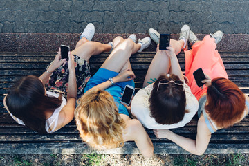 Teenage girls using mobile phones