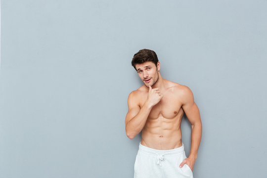 Portrait of handsome shirtless athletic young man