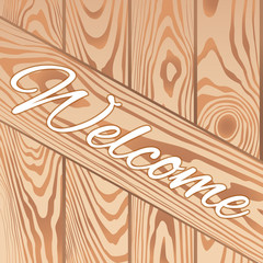 Welcome text wooden background from boards