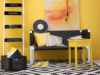 Stylish room interior on yellow wall background
