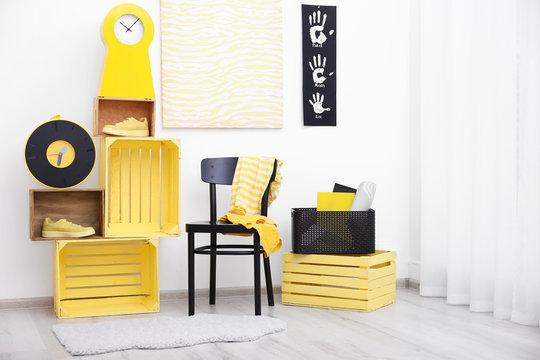 Stylish room interior with yellow furniture