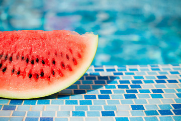 slices of fresh juicy organic watermelon on a pool