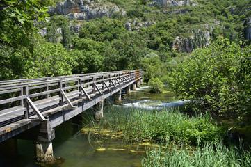 A wooden walkway across the 'Pearl Necklaces' cascade on the River Krka in Krka National Park, Sibenik-Knin County, Croatia.