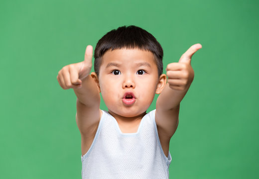 Little boy showing thumb up