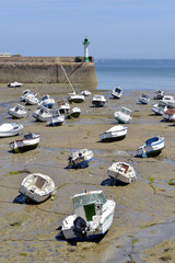 Boats at low tide in the port of Saint-Quay-Portrieux, commune in the Côtes-d'Armor department of Brittany in northwestern France.