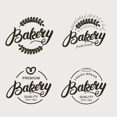 Set of bakery and bread logo. Hand written lettering logotype, badge, label, emblem. Vector illustration.