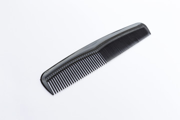 Black plastic comb on white background