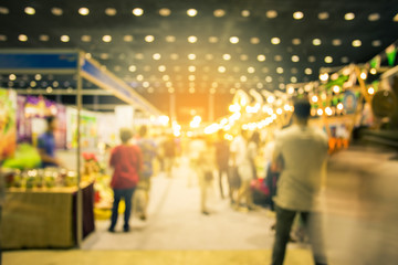 Blurred image of street market, split retro tone color effected