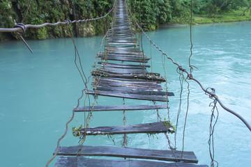 Old wooden bridge over river