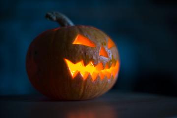 Illuminated halloween pumpkin on black background