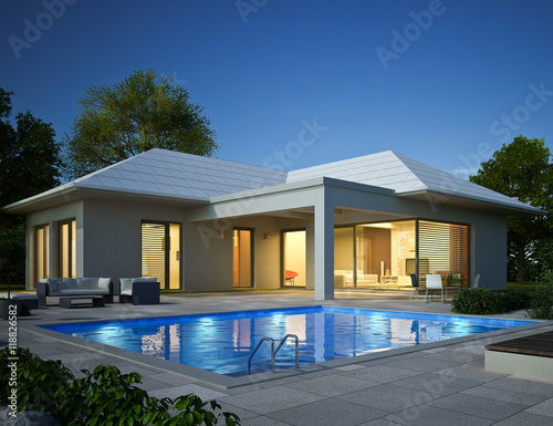bungalow mit pool am abend 118826582. Black Bedroom Furniture Sets. Home Design Ideas